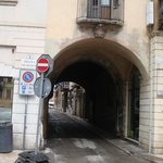 The archway of Vicolo Volto San Luca street. The Hotel San Luca is just past (going under the ar