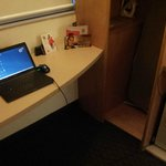 AC power outlet inconveniently located away from the desk
