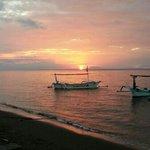 lovina sunset at the back of hotel