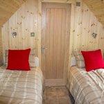 Beds/bedroom with door to bathroom