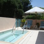 Suite private jacuzzi and lounge chairs