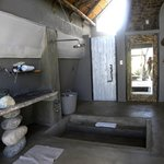 The bathroom uses local materials in a unique manner.