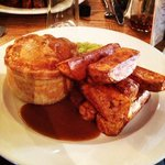 Beef and ale pie, fat chips, mushy peas