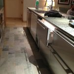 Kitchen counter with dishwasher, refrigerator and freezer drawers including ice maker