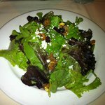 Mixed green salad with candied walnuts and feta cheese