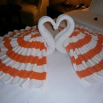 Lovely swan towels on bed