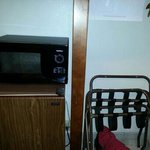 microwave and frig located in closet