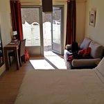 La chambre et sa mini terrasse privative