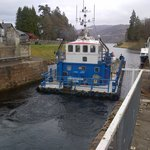 A large barge navigating the locks on the Caledonian Canal