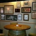 Our bar wall filled with old menu's and pictures