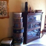 Antique hat boxes in room.