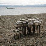 charging solar lanterns on the beach
