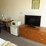 Fan provided in room; refrigertor and microwave provided (no knob); Low (but flat screen!) TV