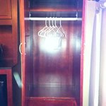 The spacious wardrobe for 4 people (5 hangers included)