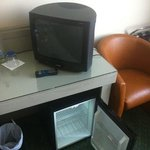 small TV and empty minibar