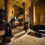 Opulent Reception area with original wrought iron staircase