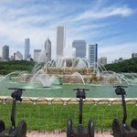 segways by the Buckinghan fountain with Chicago's cityescape