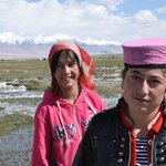 Tajik girls on the grasslands below