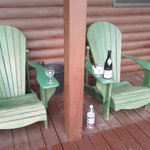 Algonquin chairs on the front and side porch invite you to relax and enjoy the serenity.
