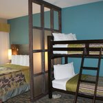 Bedroom with partition and bunk beds