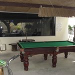 View of the pool table and free computer room behind it