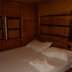 The bedroom for the non-airconditioned cottage. Quaint.