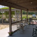 Another porch view of the rustic wine and tasting building