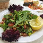 Salad with pomegranate dressing.