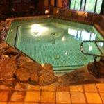 One of the two hottubs in the pool area