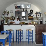 Kafeneion - lobby, check in, breakfast service, and cavehouse bar