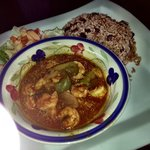 shrimp stew, rice and bean with a side salad