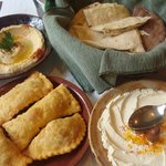 hummus, borek, labneh and assortment of fresh pita