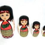 stack of maori dolls
