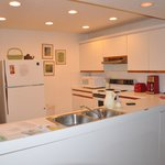 Well equipped kitchen with ice maker in freezer.