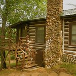 Jacks Cabin, built by hand of logs and stones in 1909. giant porch that overlooks the river vall