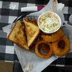 Pulled pork with Texas Toast, onion rings and slaw