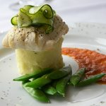 Baked Haddock on Potato Stack With Roasted Red Pepper Sauce