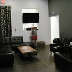 The main lounge area in the hostel, kitchen is behind TV