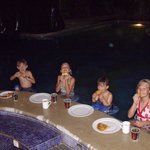 The kids enjoyed pizza at the swim-up bar in the pool at the Villa