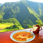 sumptuous breakfast while overlooking the hills with rising sunshine