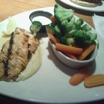 Salmon with cheese grits and vegetables. The cheese grits are delicious. So much better than ric