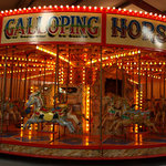 golden galloping horses carousel