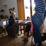Guests entertained by Federico in dining room
