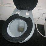 broken toilet seat in room no, 403