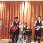 the beatles tribute group on stage