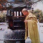 monk attending juniper twigs in brazier