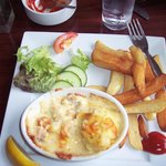 Seafood pie topped with potato and cheese