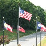 Flags over Georgia Roundabout coming into Resort