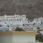 another view of hotel in the hills from beach