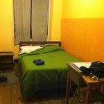 Room with double bed and private bathroom.